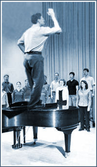 Student teacher on top of piano